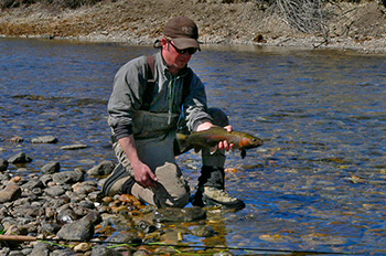 Zach Pleshar with Boulder River rainbow trout